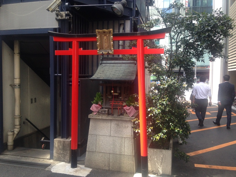 Mini Shinto gateway on the street corner